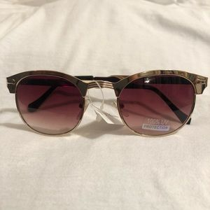 BCBGeneration Gold Rimmed Sunglasses